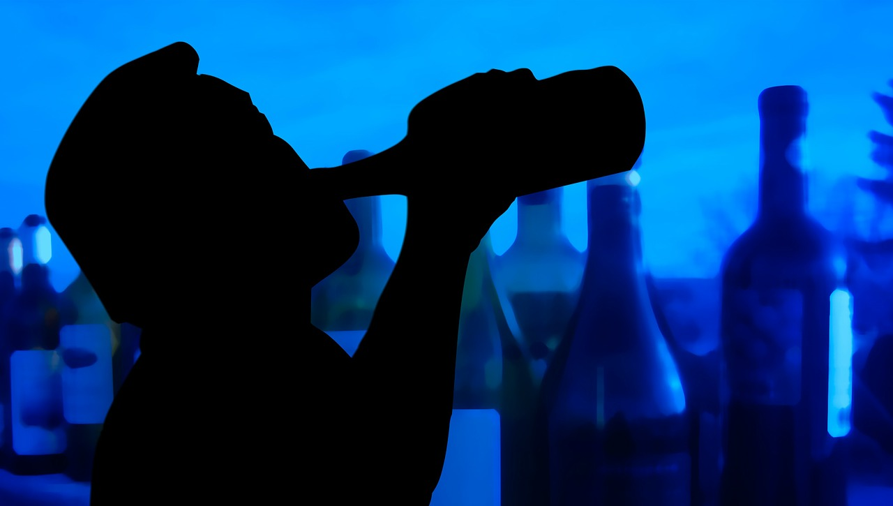 silhouete of man with bottle